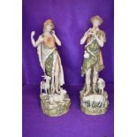 A pair of shepherd figures by Royal Dux having stamp to base one figure having slight damage