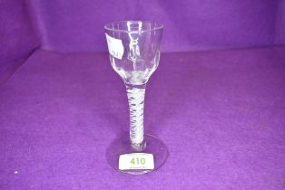 A late 18th century cordial glass having double opaque twist stem domed foot and ribbed bowl