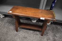 A traditional styled oak stool or step having pegged stetcher