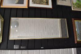 A long dressing mirror having bevel edged glass