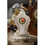 A ceramic mantel clock made in Italy with a German movement