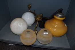 A selection of vintage light and lamp shades including milk glass brass fitment and Guzzini style