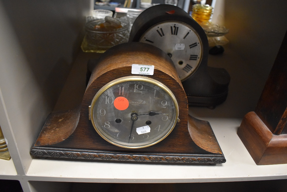 A mid century Napoleon mantel clock by Fowler and Oldfield of Bradford