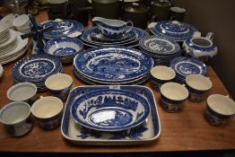 A good selection of blue and white willow wear dinner and tea wears including Royal Tudor wear