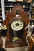 An early Ansonia Clock Co, America 8 day gingerbreaad clock