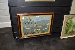 A needlework depicting bird and landscape