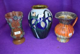 Three pieces of arts and crafts style pottery including newt or lizard decorated and similar Adams