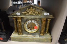A marble mantel clock with green pillar design by W H Skinner of St Leonards on sea