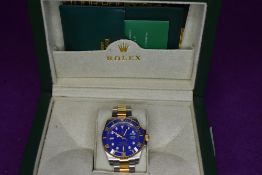 A gent's fashion wrist watch having blue face bearing name Rolex