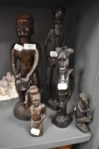 A selection of hand carved African ethnic tribal figures of various designs