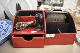 A modern desk top tidy with two Victorian photographs a tortoise shell miniature guitar and a set of