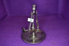 A nautical ships or similar swinging candle or chamber stick