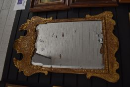 A Georgian mirror having Chippendale style carved gilt and gesso frame with silver backed mirror