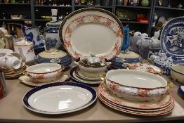 A selection of various tea and dinner wares including tureens and chargers