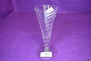 A conical ale or wine glass having a twist design of domed foot