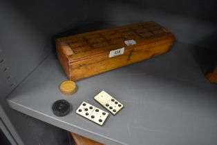 A cribbage box and board with box wood draughts and ebony and bone dominoes