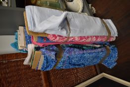 A selection of vintage and retro printed rolls of fabric and upholstery material