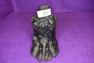 A cast iron animal paw ideal as door stop