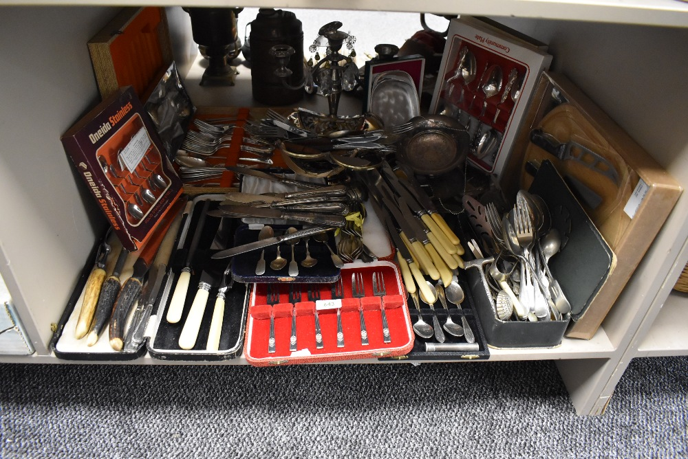 A large selection of loose and cased flatware and cutlery including carving sets Community plate and