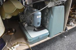 A vintage Jones model C sewing machine.