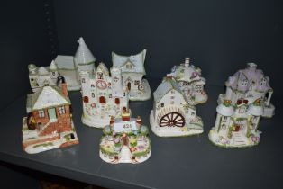 Ten ceramic model figure studies of cottages and buildings by Coalport all in fine condition