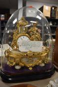 A French Ormilou gilt allabaster mantel clock (damage to dome)