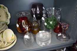 A selection of clear cut and colour art glass including large brandy or wine glass and bells