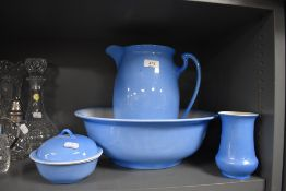 A wash jug and bowl set having a sky blue and cream glaze all pieces in good condition