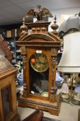A German framed 8 day steeple clock with carved decoration