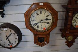 An American 8 day wall clock by Seth Thomas