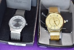 A gents gold plated fashion wrist watch by Christin Lars and a similar steel coloured wrist watch by