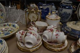 A part tea service by Elizabethan in the Queens Rose design and similar mantle clock