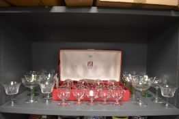 A selection of fine clear cut crystal and etched champagne wine and spirit glasses including Marie