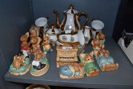 A selection of collectable figures by Pendelfin and a tea service