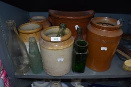 A selection of stoneware jars glass bottles and large salt glazed grain tub
