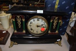 An American 8 day Marble effect mantel clock
