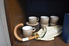 A vintage parasol or umbrella and a selection of Hornsea pottery tea cups and saucers