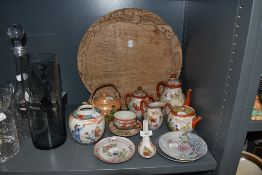 A selection of Chinese styled ceramics and porcelain including wooden bread board with dragon