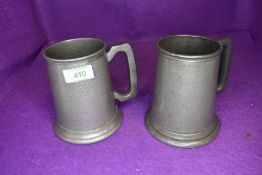 Two pewter beer mugs or tankard one glass bottom and one by Craftsman