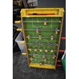 A retro table top football game.