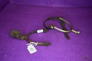 Two horse riding spurs one traditional design and similar middle eastern or Islamic style