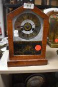 An American wood framed mantel clock