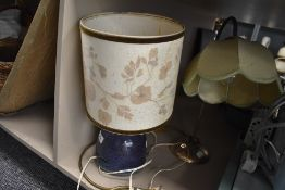 A ceramic studio pottery lamp base with flambe glaze and similar metal table lamp
