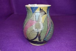 A hand painted art deco styled studio pottery vase marked Caton 5YR to base
