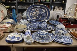 A good selection of various blue and white ware ceramics and porcelain including carpet bowls and