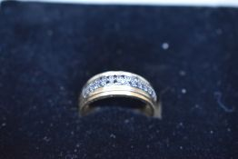 A 9ct gold band ring having a double row of black diamond chips, size W & approx 2.9g