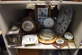 A shelf of clocks and parts (spares and repairs)