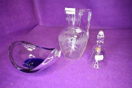 An art glass bowl with blue hue a water jug etched with holly leaf and a small bell