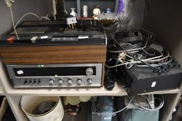 An Akai CS-33D cassette player a Rotel receiver and Pioneer CD player