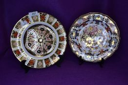 Two ceramic display plates by Royal Crown Derby in Imari designs